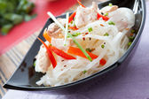 Rice noodles with chunks of tuna — Stock Photo