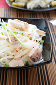 Mouthwatering rice vermicelli with chunks of tuna — Stock Photo