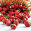 Stock Photo: Strawberries sprinkled on surface