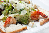 Salad with seafood and green lettuce — Stock Photo