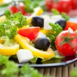 Stock Photo: Vegetable salad with feta, olives and yellow pepper
