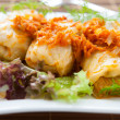 Stuffed cabbage with carrot sauce - Stock Photo