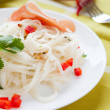 Stock Photo: Rice noodles with cilantro on white plate