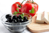 Olives in a clear salad bowl — Stock Photo