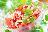 Salad of fresh red pepper in a glass bowl — Stock Photo