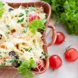 Pasta baked with grated cheese — Stock Photo