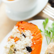Baked pumpkin with rice and raisins and cup of tea — Stock Photo