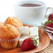 Breakfast: strawberry, cream cheese, muffins, tea — Stock Photo #21614097