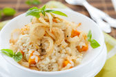 Risotto with crispy onions in whie bowl — Stock Photo