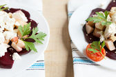 Two plates of salad with beets and goat cheese — Stock Photo
