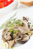 Roasted oyster mushrooms on a white plate — Stock Photo