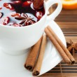 Stock Photo: Traditional mulled wine with almonds and cinnamon