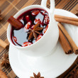 Traditional hot wine with almonds and cinnamon - Stock Photo