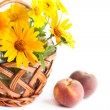 Small bouquet of yellow marigolds and peaches — Stock Photo
