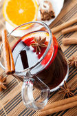 Large glass of hot wine with spices — Stock Photo