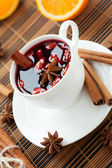 Traditional hot wine with almonds and cinnamon — Stock Photo