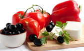 Tomatoes, olives, peppers, feta cheese — Stock Photo