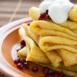 Pancakes with turmeric and sour cream — Stock Photo