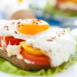 Appetizing and flavorful fried eggs with vegetables — Stock Photo