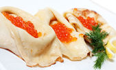 Hot pancakes with red caviar — Stock Photo