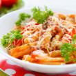 Pasta with vegetables and grated cheese with tomato sauce — Stock Photo