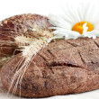 Two loaves of bread and wheat ears - Stock Photo