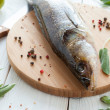 Raw zander and spices on a cutting board, fish - Stock Photo