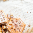 Ruddy homemade waffles with powder and wheat ears - Stock Photo