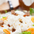 Sweet cottage cheese on a plate with dried fruit — Stock Photo #22325999