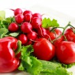 Branch of tomato, a pepper, a bunch of radishes, lettuce - Stock Photo