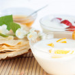 Two yogurt with fruit and pancakes on a plate — Stock Photo