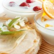 Golden pancakes and two fruit yogurt — Stock Photo