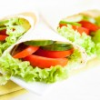 Cucumbers, tomatoes and salad in pita — Stock Photo #22346171
