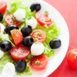 Caprese salad with mozzarella balls — Stock Photo