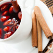 Mulled wine flavored with cinnamon and spices - Stock Photo