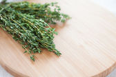 Sprigs of thyme on the board — Stock Photo