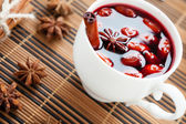 Mulled wine in a white cup and star anise — Stock Photo