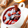 Stock Photo: Warm wine with cinnamon and nuts, mulled wine