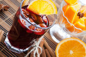 Warm wine with almonds and orange — Stock Photo