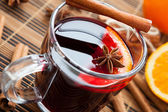 Warming drink in a large cup of mulled wine — Stock Photo