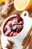 Warm wine with cinnamon and nuts, mulled wine — Stock Photo