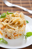Delicious risotto with onions and pumpkin — Stock Photo
