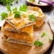 Tasty meat pie pieces and parsley — Stock Photo