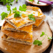 Tasty meat pie pieces and parsley — Stock Photo #22670341