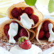 Fresh pancakes. Strawberries and cream inside - Stock Photo