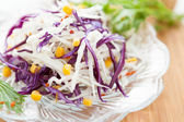 Salad of fresh cabbage and of canned corn — Stock Photo