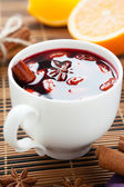 Traditional hot beverage from warm wine with spices — Stock Photo