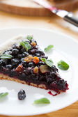 Large piece of berry pie, black currants and blueberries — Stock Photo