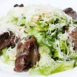 Fried liver with green salad - Stock Photo