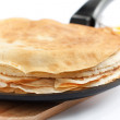 Pancakes in a frying pan — Stock Photo #22860464